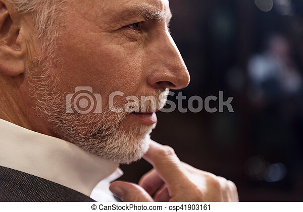 Close-up of senior man with fingers on chin - csp41903161