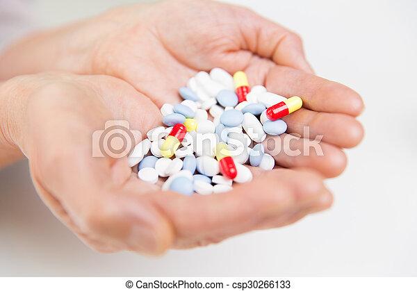 close up of senior woman hands with pills - csp30266133