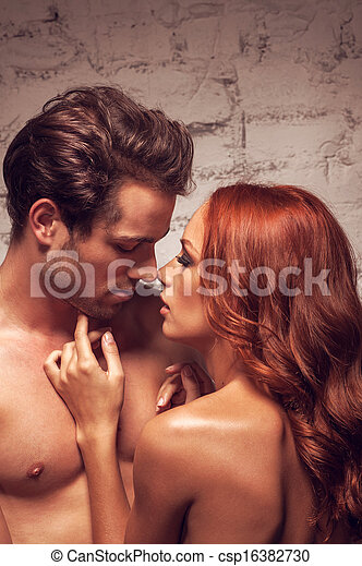 Close up of sexy nude couple going to kiss. Beautiful girl touching man's face  - csp16382730