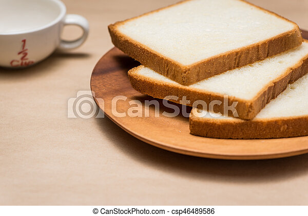 close up of slice of toast bread on wood table