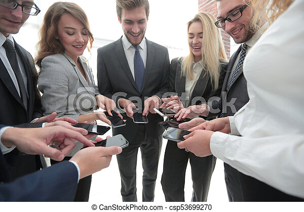 close-up of smartphones in the hands of business youth - csp53699270