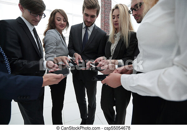 close-up of smartphones in the hands of business youth - csp55054678