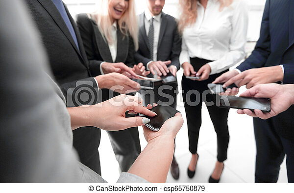close-up of smartphones in the hands of business youth - csp65750879