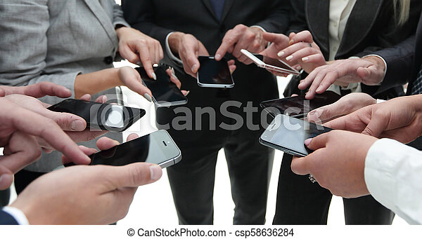 close-up of smartphones in the hands of business youth - csp58636284