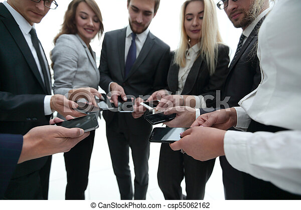 close-up of smartphones in the hands of business youth - csp55062162