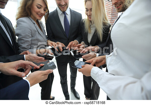close-up of smartphones in the hands of business youth - csp58718168