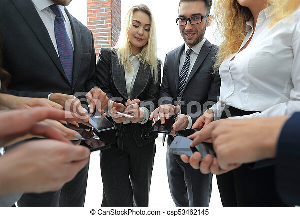 close-up of smartphones in the hands of business youth - csp53462145