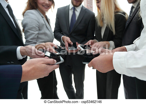 close-up of smartphones in the hands of business youth - csp53462146