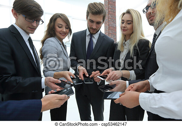 close-up of smartphones in the hands of business youth - csp53462147