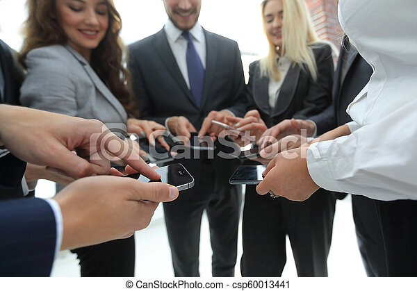 close-up of smartphones in the hands of business youth - csp60013441