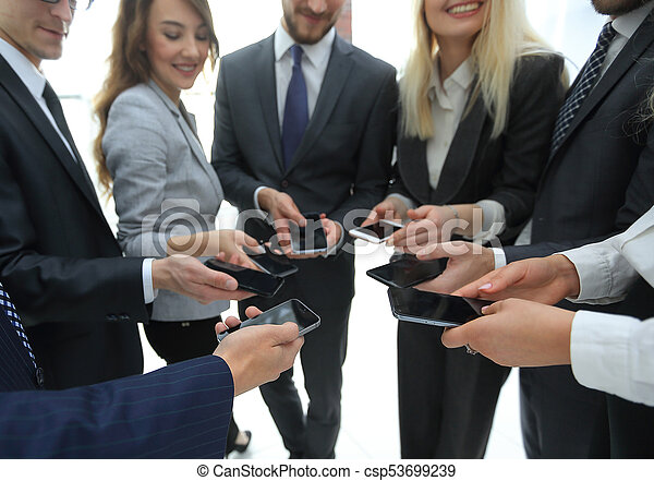 close-up of smartphones in the hands of business youth - csp53699239