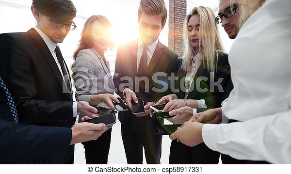 close-up of smartphones in the hands of business youth - csp58917331