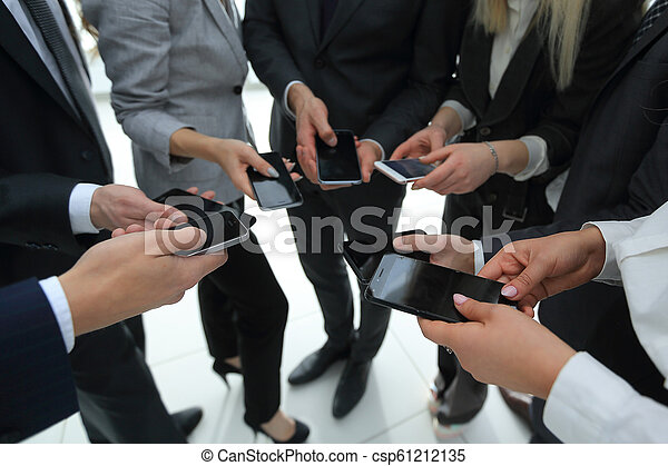 close-up of smartphones in the hands of business youth - csp61212135