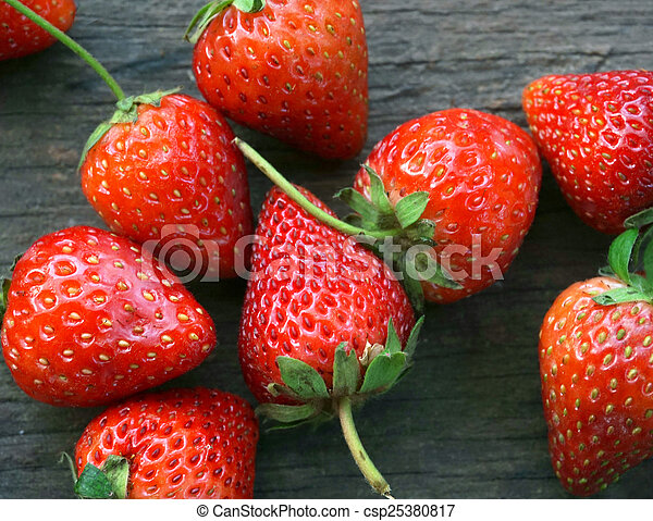 close up of straberries on wooden table - csp25380817