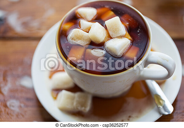 close up of sugar in coffee cup on wooden table - csp36252577