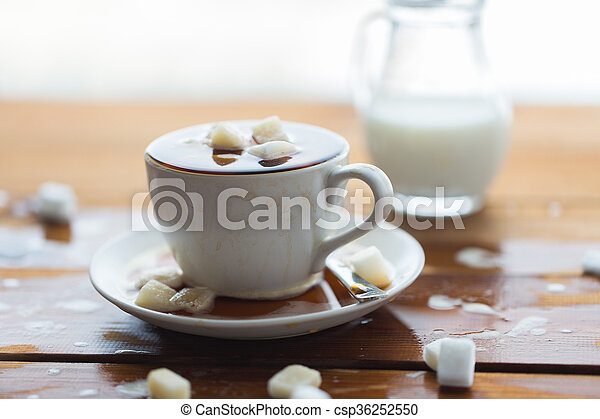 close up of sugar in coffee cup on wooden table - csp36252550