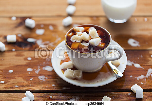 close up of sugar in coffee cup on wooden table - csp36345641