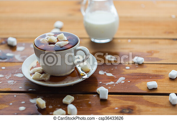 close up of sugar in coffee cup on wooden table - csp36433626