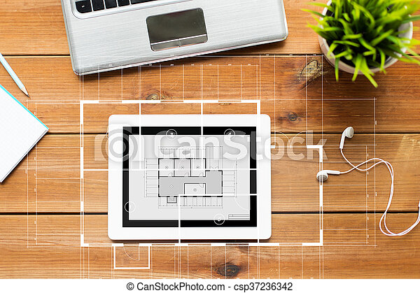 close up of tablet pc computer on wooden table - csp37236342