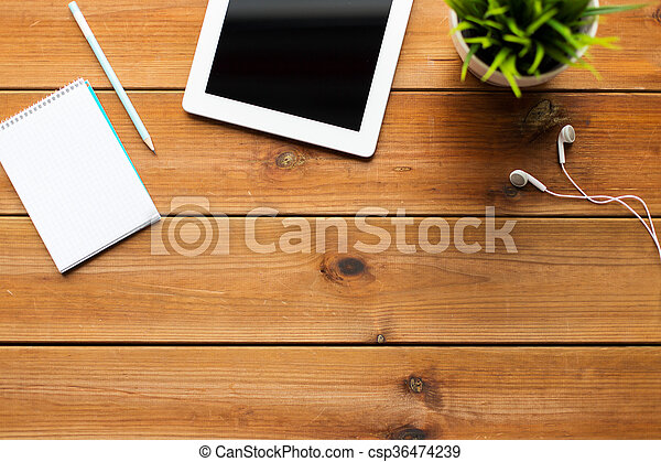 close up of tablet pc computer on wooden table - csp36474239