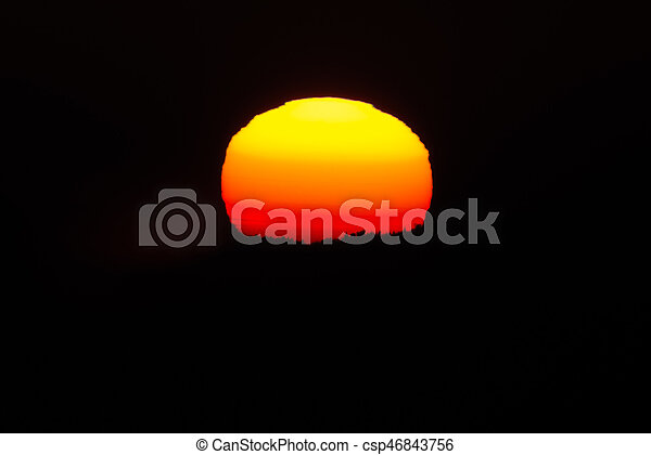 Close up of the sun during sunset at a cold winter night - csp46843756