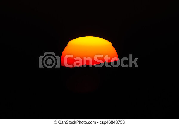 Close up of the sun during sunset at a cold winter night - csp46843758