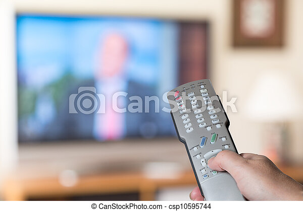 Close up of TV remote control with television - csp10595744