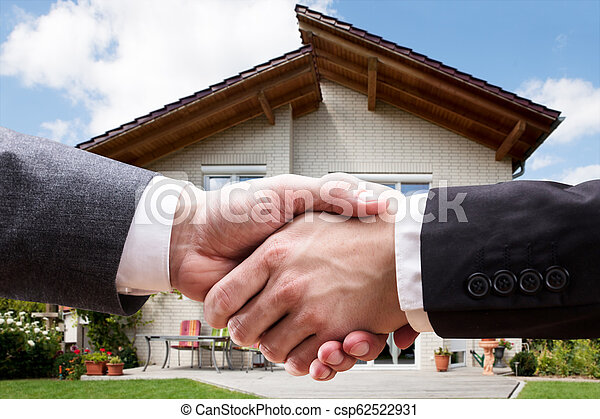 Close-up Of Two Businesspeople Shaking Hands - csp62522931