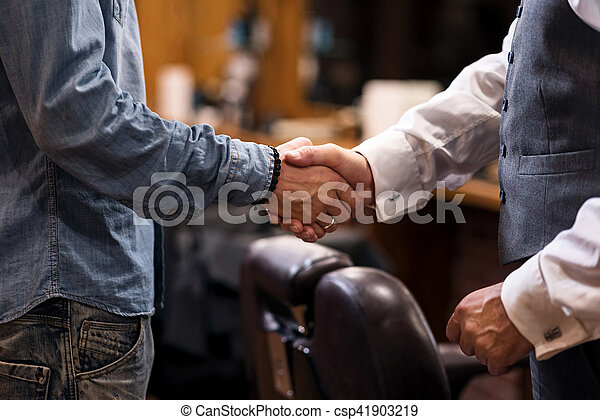 Close up of two man shaking hands - csp41903219