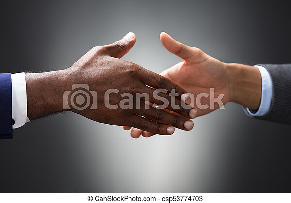 Close-up Of Two People Shaking Hands - csp53774703