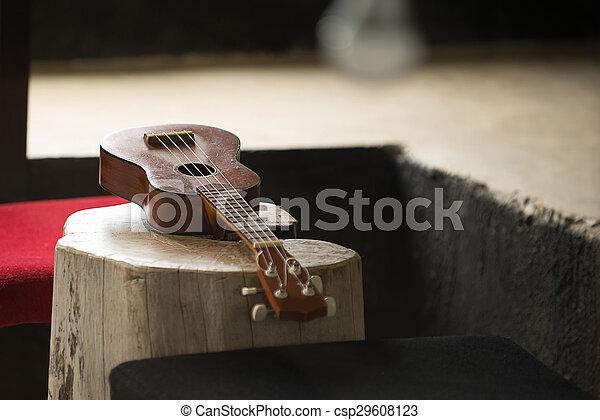 Close up of ukulele on old wood background with soft light, Vintage tone - csp29608123