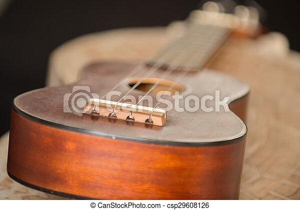 Close up of ukulele on old wood background with soft light, Vintage tone - csp29608126