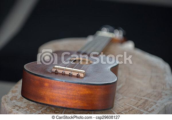 Close up of ukulele on old wood background with soft light, Vintage tone - csp29608127