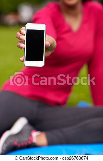close up of woman african american with smartphone - csp26763674