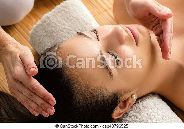 Close up of woman at reiki session. - csp40796525