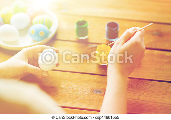 close up of woman coloring easter eggs - csp44681555