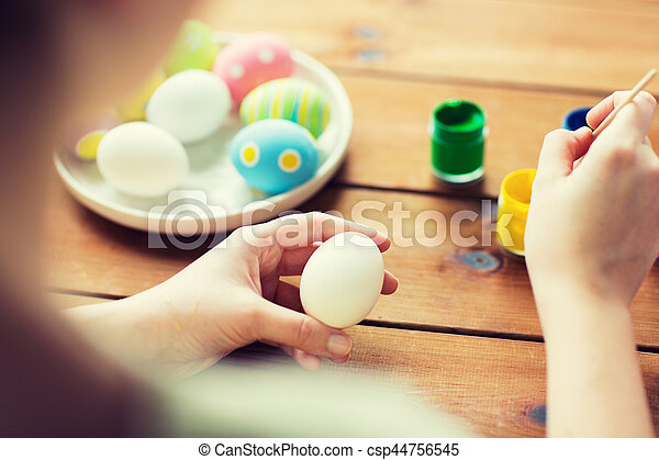 close up of woman coloring easter eggs - csp44756545