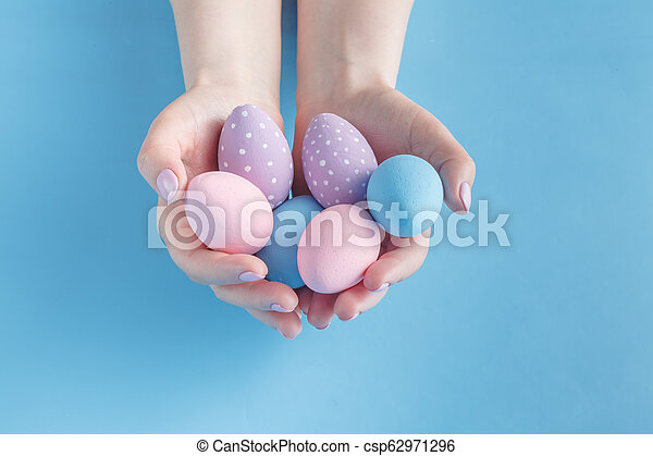 Close up of woman holding colorful Easter eggs - csp62971296