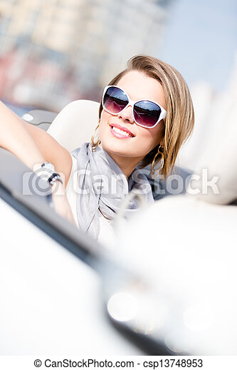 Close up of woman in the automobile - csp13748953