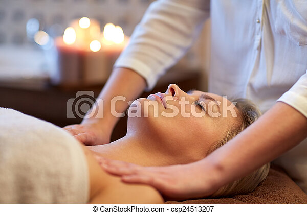 close up of woman lying and having massage in spa - csp24513207