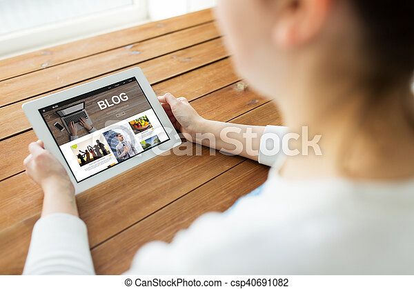 close up of woman with blog on tablet pc - csp40691082