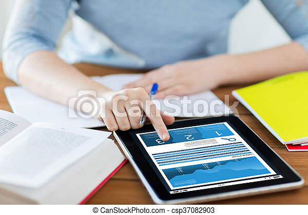 close up of woman with chart on tablet pc - csp37082903