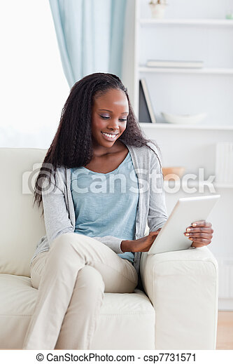 Close up of woman with tablet on couch - csp7731571