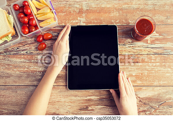 close up of woman with tablet pc food on table - csp35053072