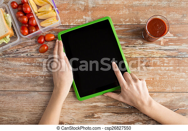 close up of woman with tablet pc food on table - csp26827550