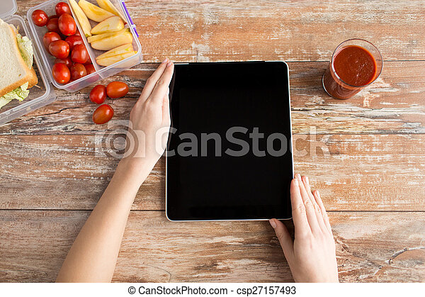 close up of woman with tablet pc food on table - csp27157493