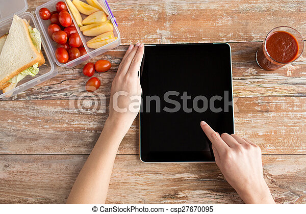 close up of woman with tablet pc food on table - csp27670095