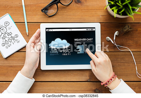 close up of woman with tablet pc on wooden table - csp38332845