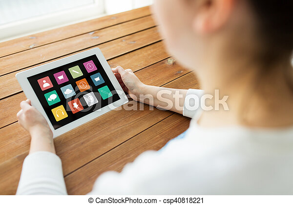 close up of woman with tablet pc on wooden table - csp40818221
