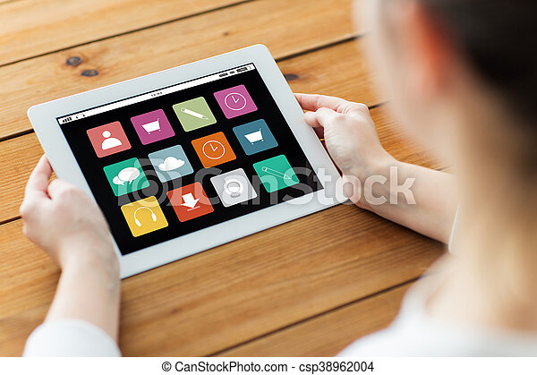 close up of woman with tablet pc on wooden table - csp38962004